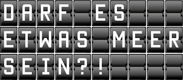 Schwarze Texttafel mit Aufschrift: Darf es etwas meer sein?